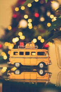 Macro Shot Locksmith Holiday Brown Volkswagen Van Figure on Table